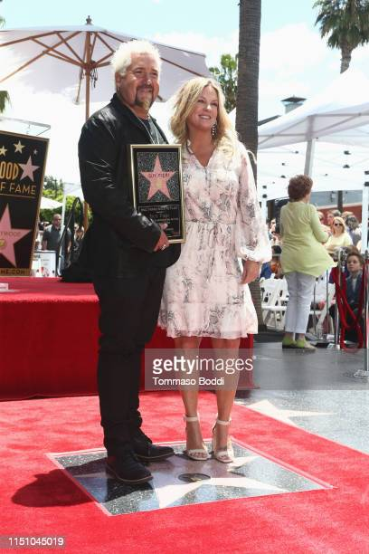 Guy Fieri and Lori Fieri attend a ceremony honoring Guy Fieri with a star on the Hollywood Walk of Fame on May 22 2019 in Hollywood California
