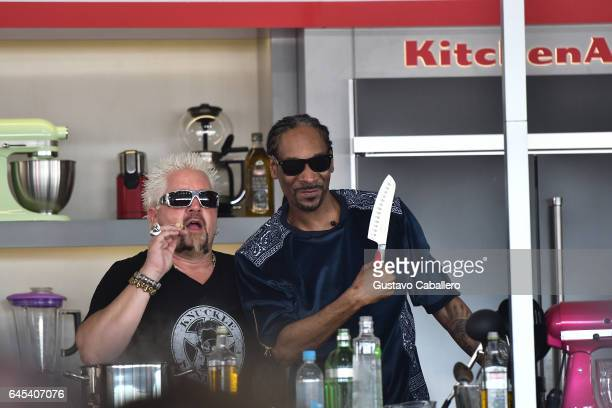 Guy Fieri and Snoop Dogg cook on stage at Goya Foods' Grand Tasting Village Featuring Mastercard Grand Tasting Tents KitchenAid Culinary...