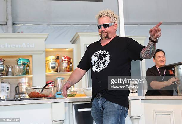Guy Fieri prepares food at the Whole Foods Market Grand Tasting Village Featuring MasterCard Grand Tasting Tents KitchenAid® Culinary Demonstrations...