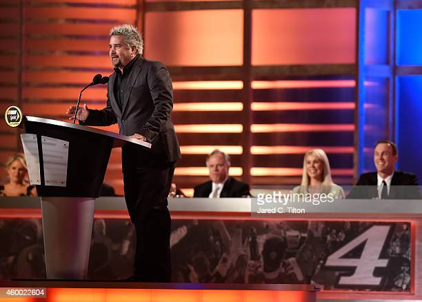 Guy Fieri presents an award during the 2014 NASCAR Sprint Cup Series Awards at Wynn Las Vegas on December 5, 2014 in Las Vegas, Nevada.