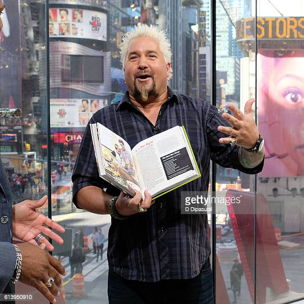 Guy Fieri visits 'Extra' at their New York studios at HM in Times Square on October 11 2016 in New York City