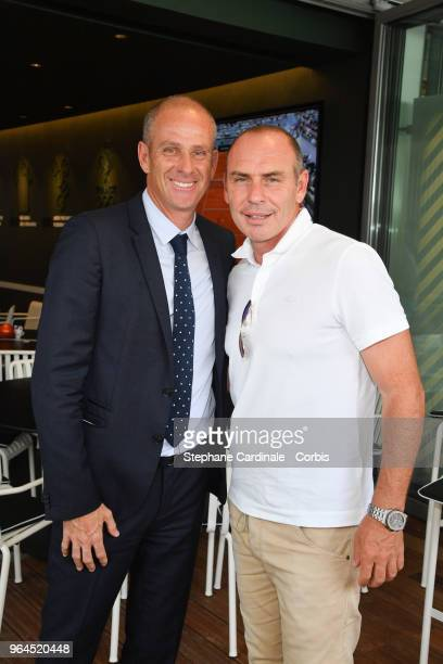 Guy Forget and Alain Boghossian attend the 2018 French Open Day Five at Roland Garros on May 31 2018 in Paris France