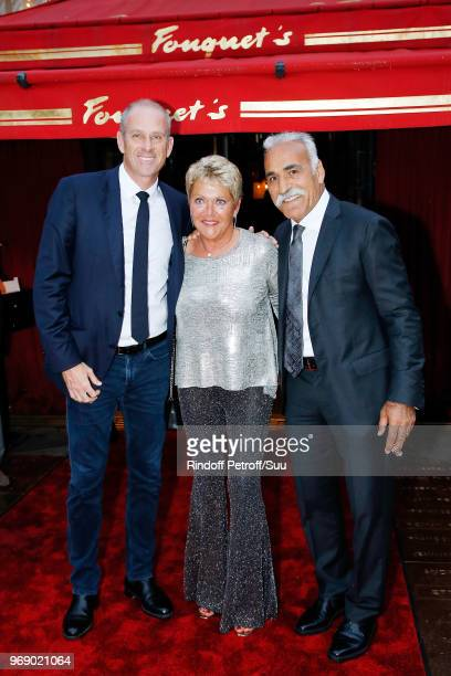 "Guy Forget, Frederique Bahrami and Mansour Bahrami attend ""Diner des Legendes"" at Le Fouquet's on June 6, 2018 in Paris, France."
