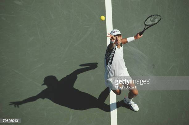 Guy Forget of France serves to Felix Mantilla Botella during their Men's Singles second round match of the United States Open Tennis Championship on...