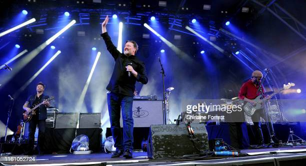 Guy Garvey Mark potter Craig Potter and Pete Turner of Elbow perform at Castlefield Bowl on July 09 2019 in Manchester England