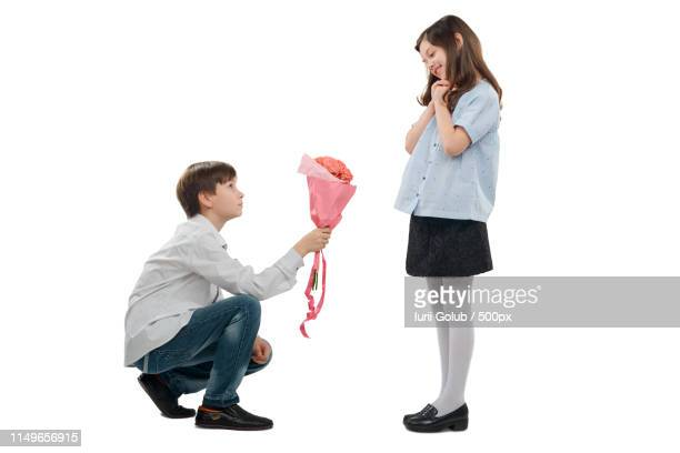 guy giving flowers to girlfriend - little girl giving head stock photos and pictures