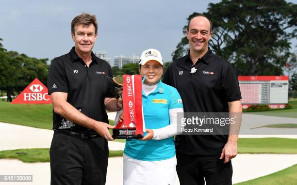 Guy Harvey Samuel CEO at HSBC Singapore presents Inbee Park of Korea with the winners trophy along with Giles Morgan Head of Sponsorship Events at...