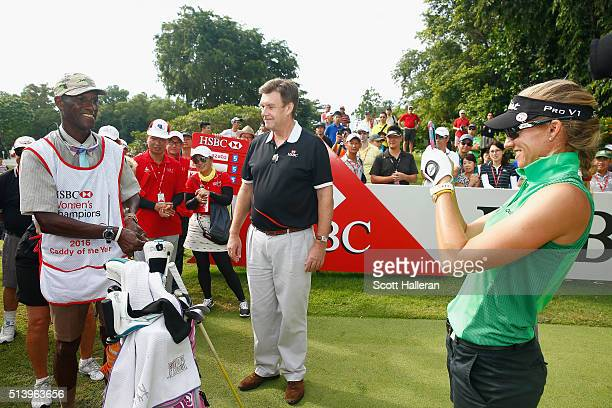 Guy Harvey Samuel HSBC CEO Singapore looks on as Caddy of the Year winner Thomas Frank is photographed by his player Kris Tamulis of the United...