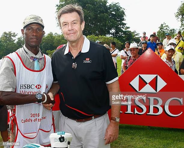 Guy Harvey Samuel HSBC CEO Singapore presents Thomas Frank the caddy for Kris Tamulis of the United States with his Caddy of the Year Bib during the...