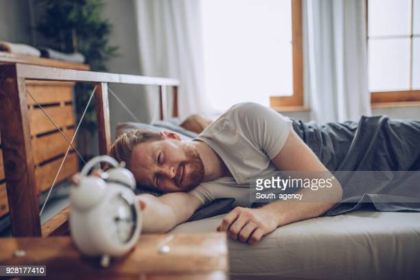 guy hates getting up early - waking up stock pictures, royalty-free photos & images