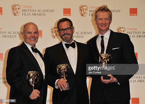 Guy Hendrix Dyas Larry Dias and Doug Mowat the winners of the Production Design award for 'Inception' pose during the Orange British Academy Film...