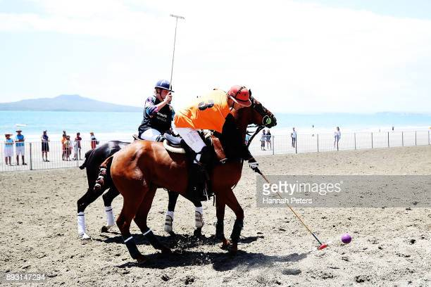 Guy Higginson competes for the ball during 2018 Takapuna Beach Polo on December 15 2017 in Auckland New Zealand