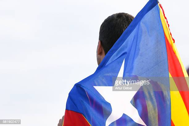 Guy holding Catalan separatists flag
