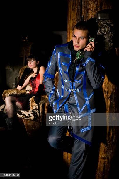 guy is talking on the phone - haute couture stockfoto's en -beelden