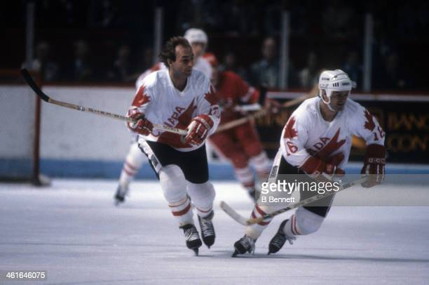 Guy Lafleur and Marcel Dionnne of Canada skate on the ice during the 1981 Canada Cup Final against the Soviet Union on September 13 1981 at the...