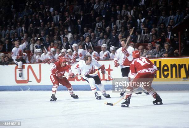 Guy Lafleur of Canada skates with the puck as he is defended by Sergei Makarov and Zinetula Bilyaletdinov of the Soviet Union during the 1981 Canada...