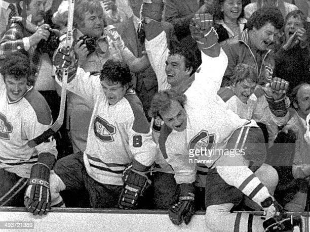 Guy Lafleur of the Montreal Canadiens leads the celebration as teammates Yvon Lambert Doug Risebrough Mario Tremblay and Pierre Mondou join in after...
