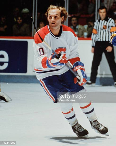 Guy Lafleur of the Montreal Canadiens skates during a game Circa 1976 at the Montreal Forum in Montreal Quebec Canada