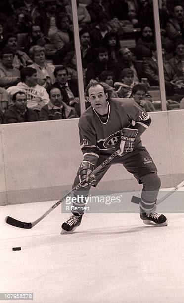 Guy Lafleur of the Montreal Canadiens skates with the puck before scoring his 500th career goal during the game against the New Jersey Devils at...