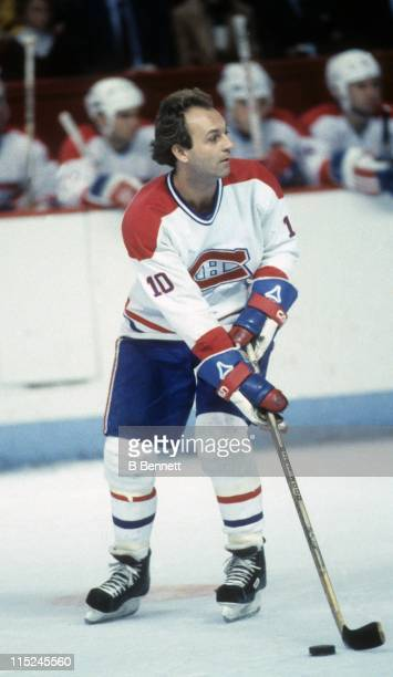 Guy Lafleur of the Montreal Canadiens skates with the puck during an NHL game in December 1983 at the Montreal Forum in Montreal Quebec Canada