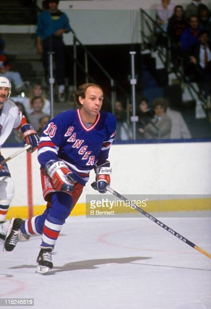 Guy Lafleur of the New York Rangers skates on the ice during an NHL game against the New York Islanders circa 1988 at the Nassau Coliseum in...