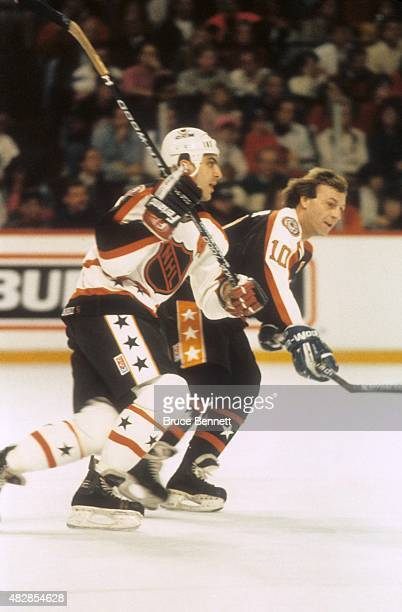 Guy Lafleur of the Wales Conference and the Quebec Nordiques and Chris Chelios of the Campbell Conference and the Chicago Blackhawks skate on the ice...