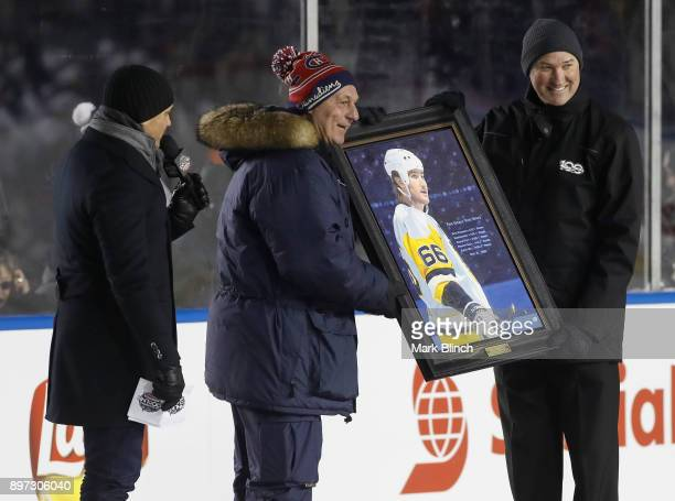 Guy Lafleur presents Mario Lemieux with an award after his 'Five Goals Five Ways' was named the greatest NHL moment during the 2017 Scotiabank NHL...