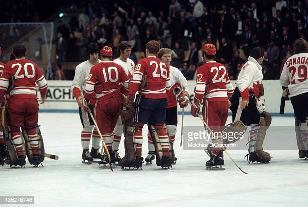 Guy Lapointe Jean Ratelle and Pat Stapleton of Canada shake hands with Aleksandr Maltsev Yevgeny Poladiev and Vyacheslav Anisin after Game 8 of the...