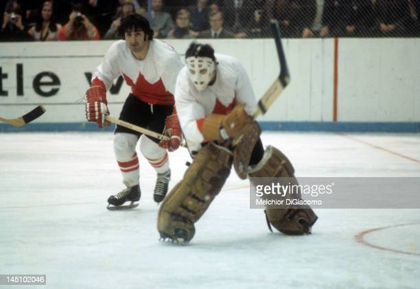 Guy Lapointe of Canada watches his teammate goalie Tony Esposito move the puck during the game against the Soviet Union in the 1972 Summit Series in...