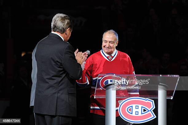 Guy Lapointe talks to fans during his jersey retirement ceremony prior to the NHL game between the Montreal Canadiens and the Minnesota Wild at the...