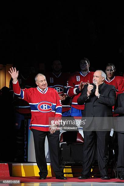 Guy Lapointe waves to fans during his jersey retirement ceremony prior to the NHL game between the Montreal Canadiens and the Minnesota Wild at the...