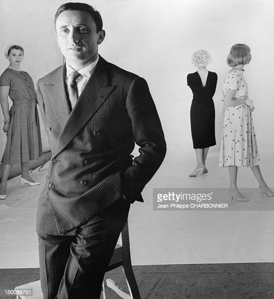 Guy laroche posing with his models 1957 in Paris France