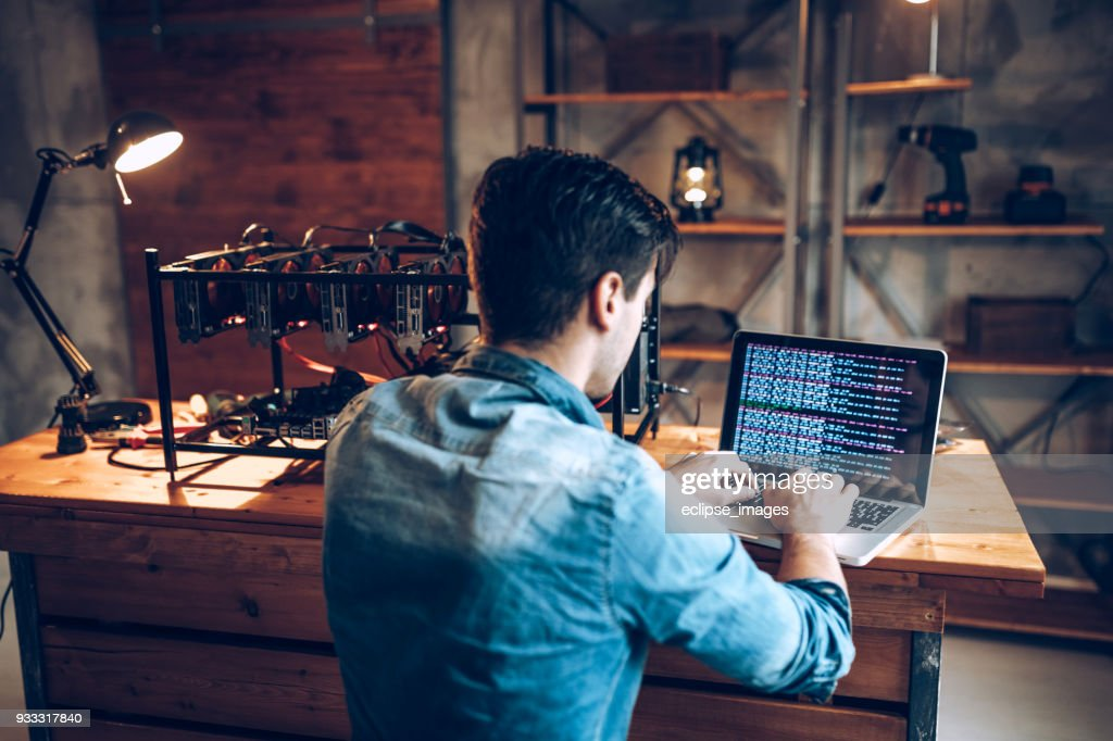 IT guy launching his first mining rig for cryptocurrency : Stock Photo