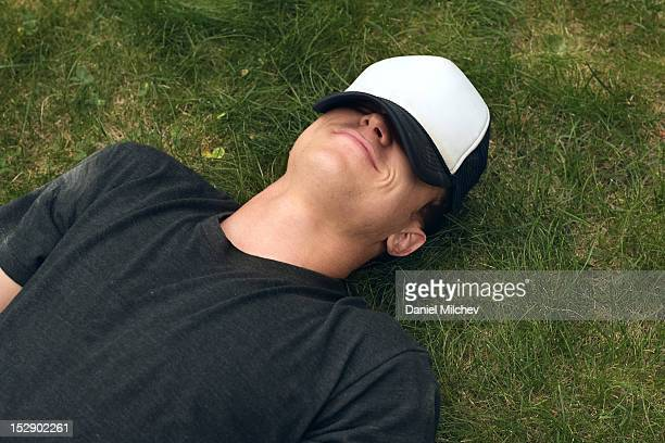 Guy laying on the grass.