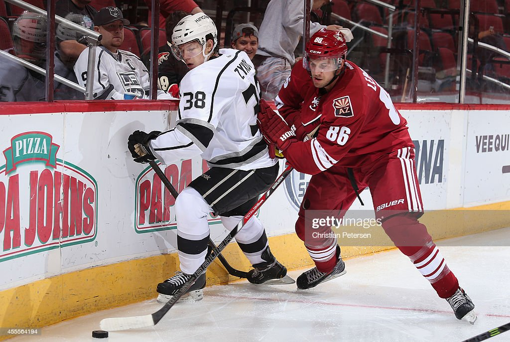 Guy Leboeuf #86 of the Arizona Coyotes checks Valentin Zykov #38 of the Los Angeles Kings off the puck during the NHL rookie camp game at Gila River Arena on September 16, 2014 in Glendale, Arizona.