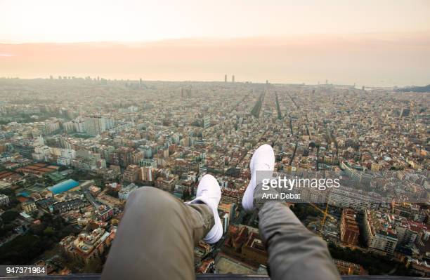 Guy legs from helicopter view with stunning cityscape.