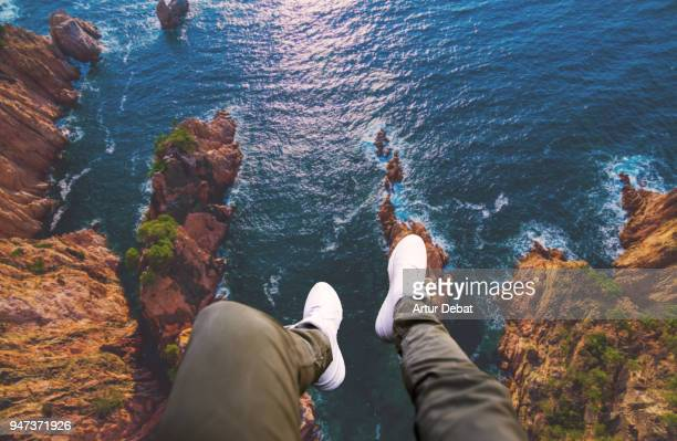 Guy legs from helicopter view with stunning landscape.