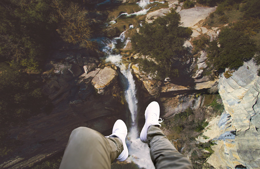 Guy legs from helicopter view with stunning waterfall landscape. - gettyimageskorea