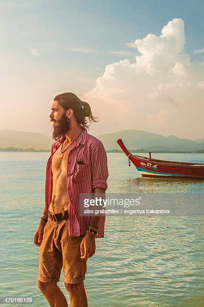 guy looking into the distance at sea