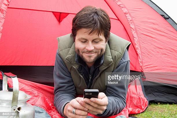 Guy lying outside a tent