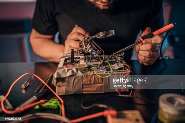 guy making a time bomb - time bomb stock photos and pictures