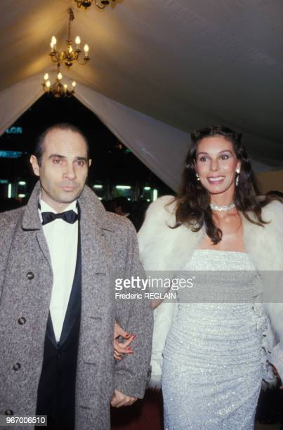 Guy Marchand et son épouse Béatrice lors d'une soirée au Lido le 14 mars 1985 à Paris, France.