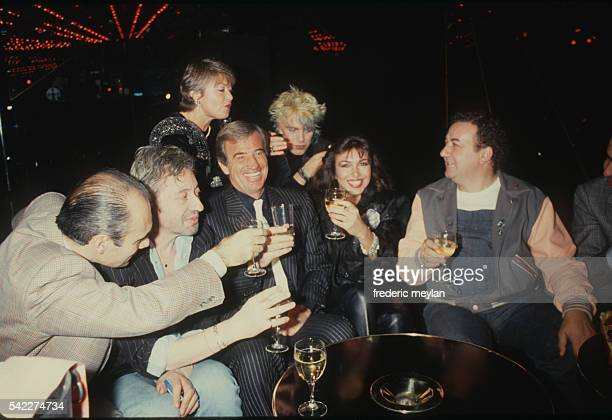 Guy Marchand Serge Gainsbourg JeanPaul Belmondo and Coluche surrounding singer Carlos Sotto Mayor for the launch of her album
