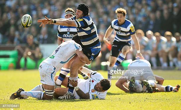 Guy Mercer of Bath is tackled by Dean Mumm and Hoani Tui of Exeter during the LV= Cup Semi Final match between Exeter Cheifs and Bath at Recreation...