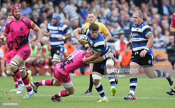 Guy Mercer of Bath runs with the ball during the Aviva Premiership match between Bath and London Welsh at the Recreation Ground on September 13 2014...