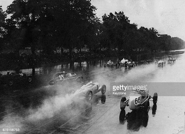 Guy Moll of France driving the Scuderia Ferrari Alfa RomeoTipo B/P3 streamliner Hermann zu Leiningen of Germany driving the Auto Union AGAuto UnionA...