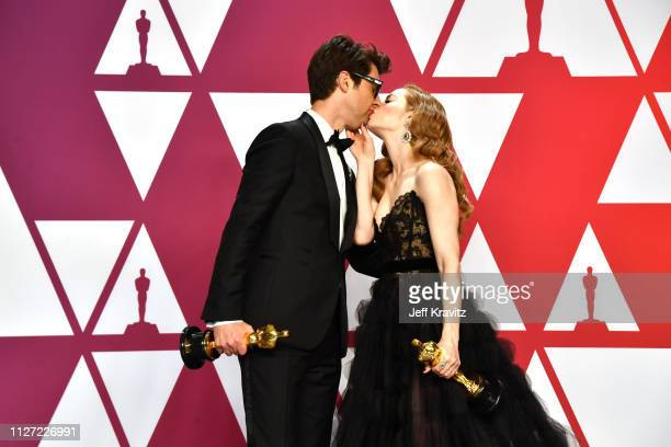 Guy Nattiv and Jaime Ray Newman winners of Best Live Action Short Film for 'Skin' pose in the press room during at Hollywood and Highland on February...