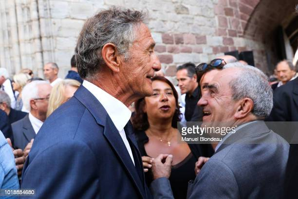 Guy Noves and Jean Gachassin are seen at the burial of Pierre Camou in Saint Jean Pied de Port during the Funeral of former rugby player Pierre Camou...