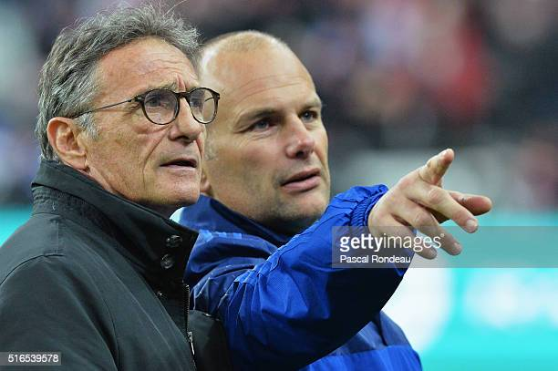 Guy Noves head coach of France and assistant Yannick Bru talk prior to the RBS Six Nations match between France and England at Stade de France on...