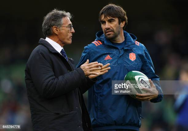 Guy Noves the head coach of France speaks with JeanFrederic Dubois the France attack coach during the RBS Six Nations match between Ireland and...